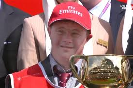 Strapper Steven Payne holds the Melbourne Cup - ABC News (Australian  Broadcasting Corporation)