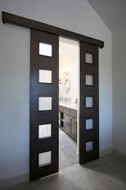 urban custom barn door entry into master bathroom modern