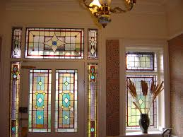 the top three panels above the door and also the two panels on the right of the doorway are our own design the blend between the original door