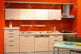 Red Wall Kitchen Small Modern Kitchen In Red Wall Apartment Stock Photo Picture