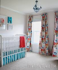 baby girl nursery with diy curtains in bright graphic fabric diy crib skirt and
