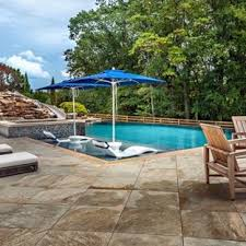infinity pool design backyard. Example Of A Huge Country Backyard Concrete Paver And Custom-shaped Infinity  Water Slide Design Pool