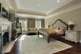 couches in bedrooms. Exellent Couches A Spacious Bedroom With Hardwood Floors And A Stately Fireplace Two Large  Windows Are Inset With Couches In Bedrooms B