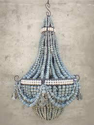 two tone blue and white ceramic beaded chandeliers made by hiv positive women in south africa proceeds go to an excellent cause