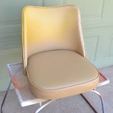 In this office chair makeover a vintage vinyl chair meets some paint &  because an absolutely. Next I spray painted ...