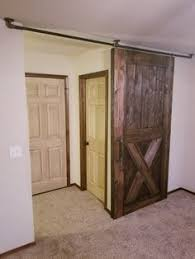 ceiling mounted barn door without paying a fortune on the hardware thewoodentoolbox rustic