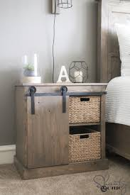 i built a new rustic modern king bed and i wanted something fun for my nightstands i have always thought that my diy barn door bathroom cabinet would make