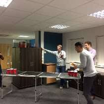 tough mudder office. lincoln england fairfax management consultants photo of beer pong tough mudder office