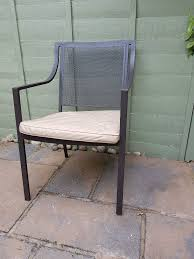 Set of 4 powdercoated steel garden chairs pre owned