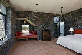 Superb ... Mediterranean Bedroom Showcases Terracotta Tiles And Dark Stone Walls  [Design: David Howell Design]