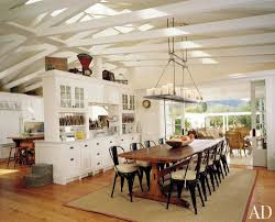 open view rustic dining room using wrought iron candle chandelier non electric over long wooden dining table set