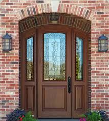 arched entry doors with decorative glass inserts and sidelight