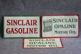 sinclair gasoline sinclair opaline motor oil embossed tin sign the auburn auction worldwide auctioneers