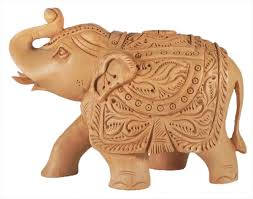 intricately wood carved elephant hover to zoom