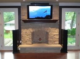 the tv over this fireplace sits directly on the mantle