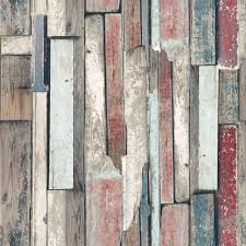 this stunningly realistic wood effect wallpaper feels reminiscent of wood salvaged from sail boats and stray driftwood the washed out red and teal colours