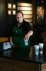 starbucks prices here to rise 3 5 times as much as nationwide starbucks shift supervisor hailey potter puts out drinks bettina hansen the seattle times