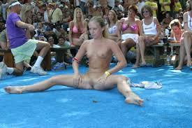Naked pretty girl spreading her legs open in public pussy