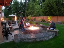 backyard designs. Fabulous Design Backyard Landscaping Ideas With Stacked Stone Round Shape Fire Pit And Benches Designs