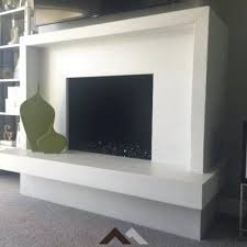 white surround and hearth concrete fireplace ideas gallery