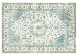 houzz outdoor rugs the muted palette of this friendly indoor outdoor rug its made from recycled plastic bottles reins in the busy asymmetrical pattern houzz