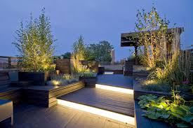 Exterior:Cool Rooftop Terrace Garden Design With Beautiful Floor Lighting  And Pallet Wooden Fence Idea