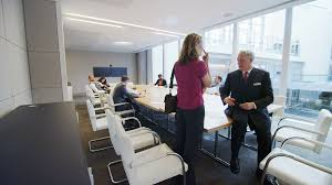 contemporary office buildings. 4k / Ultra HD Version Diverse Business Team In Boardroom Meeting A Large Contemporary Office Building Shot On RED Epic Stock Video Footage - Videoblocks Buildings