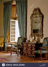Ornate Bedroom Chairs Ornate Gilt Antique Mirror Above Fireplace In Pastel Blue Bedroom
