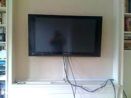 hanging tv over fireplace installing over fireplace hang above fireplace in on how to