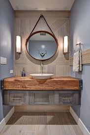 this bathroom features both earthy and elements and features a vessel sink atop a