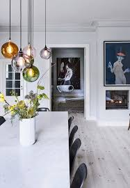 dinner table lighting. wonderful lighting beautiful pendants over the dining table in different colors throughout dinner table lighting