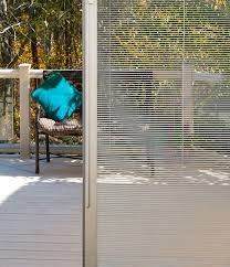 western reflections sliding patio doors with blinds between glass