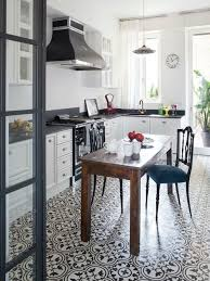 kitchen floor tiles with white cabinets. Mid-sized Farmhouse Eat-in Kitchen Designs - Inspiration For A Floor Tiles With White Cabinets