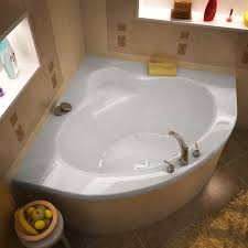 awesome soaker tub with tile flooring and tile wall surround for bathroom design