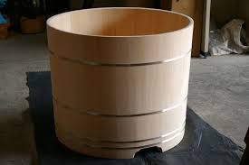 this traditional hinoki wood style tub is made by bartok design the creator is jacopo