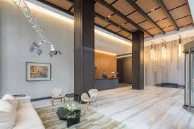 ... building, the hotel-like lobby presents a poetry of space, its soaring  ceiling held aloft by monolithic pillars. The fully attended reception desk  ...
