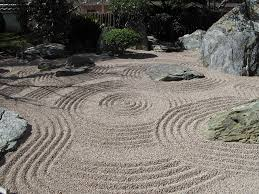 the karesansui 枯山水 as the rock garden is known in japanese is meant to be a picturesque view of mountains and rivers