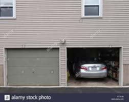open garage doorOpen garage door with car parked inside american style wooden