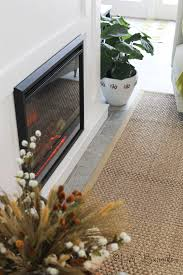 plans a and written tutorial to build a diy fireplace with an electric insert