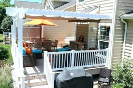 gratis patio furniture home depot design. Manual Awnings For Decks Striped Awning Extended Over Deck Furniture Gratis Patio Home Depot Design