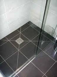 wet room porcelain floor and ceramic wall tiles supplied by porselanosa