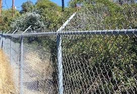 how to install chain link fence on uneven ground barbed wire cost factors how to install chain link fence