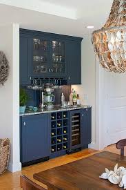 a shingled house with aqua shutters on cape cod love this dark bar mixed in built home bar cabinets tv