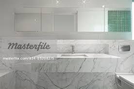 marble bathroom sink. modern marble bathroom sink - stock photo