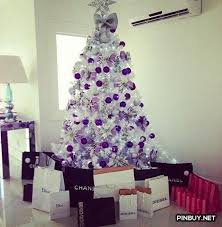 You can simply decorate your white Christmas tree with solid colored  Christmas balls. Add some purple and silver ribbons.