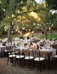 outdoor garden elegant garden wedding long table reception next exit wedding photograph