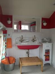 simply bathroom decoration with kohler sinks plus wall lights and cute storage