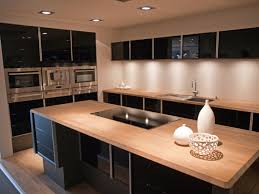 modern kitchen example with black flat panel cabinets and warm wood countertops