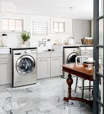 gray laundry room with stainless steel pull down drying rack