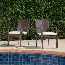 Corsica Outdoor Wicker Dining Chair with Cushion Set of 2 by Christopher Knight Home e98 d211 4e4c 847a a60a7be 600